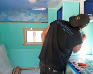 jody painting turquise trailer